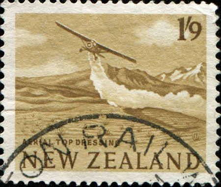 NEW ZEALAND - CIRCA 1960: A stamp printed in New Zealand shows Aerial top dressing, circa 1960  photo