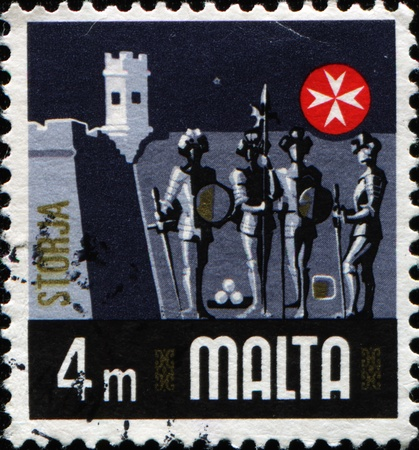 MALTA - CIRCA 1973: A stamp printed of the Sovereign Military Order of Malta shows Knights Hospitaller on the background of Fort Saint Elmo, circa 1973 photo