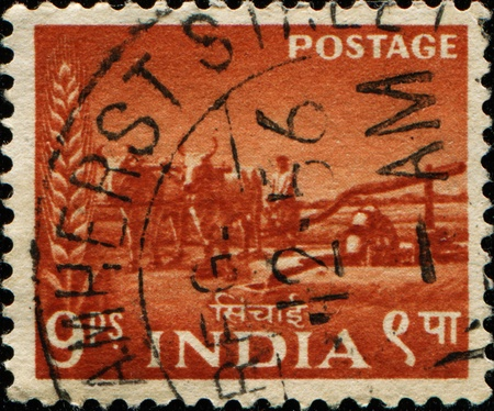 INDIA - CIRCA 1955: A stamp printed in India shows Bullock-driven well, circa 1955 photo