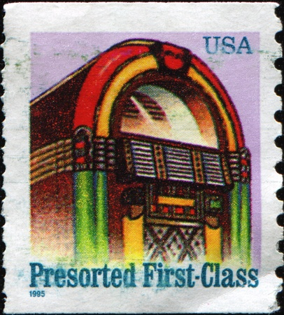 vinyl cutting: USA - CIRCA 1968: A first-class letter presort rate  (25-cent) stamp shows juke box, circa 1968
