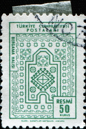 TURKEY - CIRCA 1966: A stamp printed in in Turkey shiws Carpets of Bergama pattern, series, circa 1966 photo