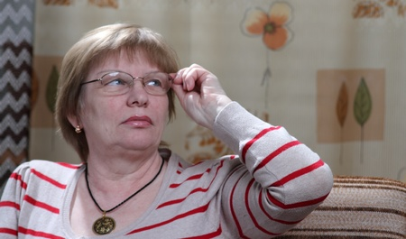 glases: senior woman in eye glases and striped jumper