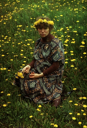 Pregnant woman sitting in the meadow with dandelions, Kursk, Russia, USSR, 1981 Stock Photo - 12971843