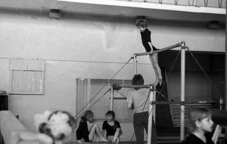 USSR - CIRCA 1975: Girls on the uneven bars at sports school, Kursk, Russia, circa 1975 Stock Photo - 13062444