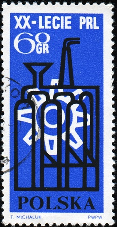 20th: POLAND -CIRCA 1964: Stamp honoring 20th Anniversary of Peoples Republic Poland shows industrial simbols, circa 1964 Editorial