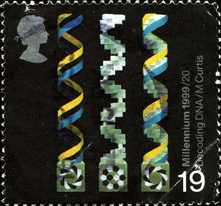 decoding: UNITED KINGDOM - CIRCA 1999: A stamp printed in Great Britain dedicated  Molecular Structures, Decoding DNA, It shows sculptures by M. Curtis, circa 1999