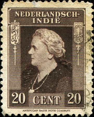 wilhelmina: DUTCH EAST INDIES - CIRCA 1945: A stamp printed in the Netherlands Indies shows image of Queen Wilhelmina of the Netherlands, circa 1945 Editorial