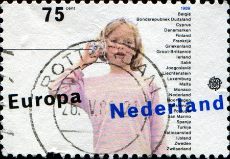 NETHERLANDS - CIRCA 1989  a stamp printed in the Netherlands shows Children Stock Photo - 13318050