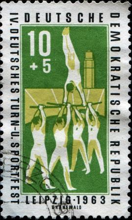 GERMANY - CIRCA 1963  A stamp printed in German Democratic Republic  shows gymnasts, circa 1963 Stock Photo - 13318047