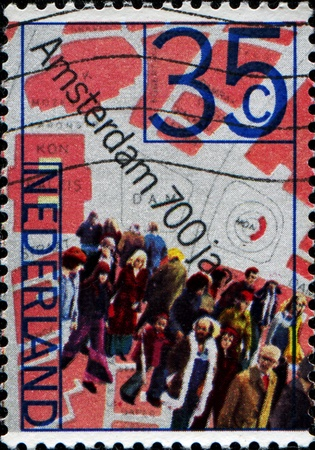 NETHERLANDS - CIRCA 1975: A stamp printed in  Netherlands shows People and Map of Dam Square, 700th anniversary of Amsterdam, circa 1975  photo
