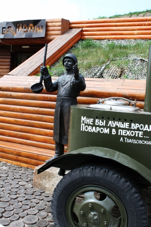 wartime: Tank battles in Prokhorovka - the largest tank battle in the history of WW II. Now are a museum. Monument to wartime cook with a kitchen next to the restaurant field dugout, Prokhorovka, Belgorod Region, Russia, An inscription in Russian poet Alexander Tw