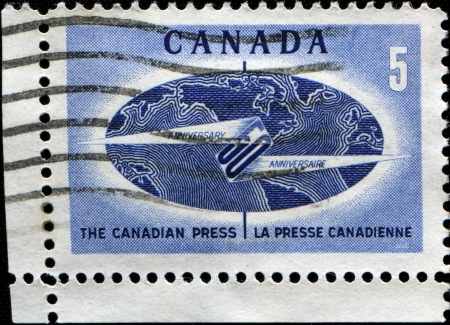 CANADA - CIRCA 1967: A stamp printed in Canada honoring 50th Anniversary of the Canadian Press, circa 1967 photo