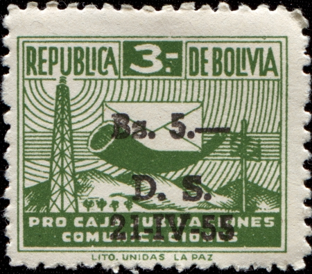BOLIVIA - CIRCA 1944: A stamp printed in Bolivia shows Posthorn and Envelope, circa 1944 photo