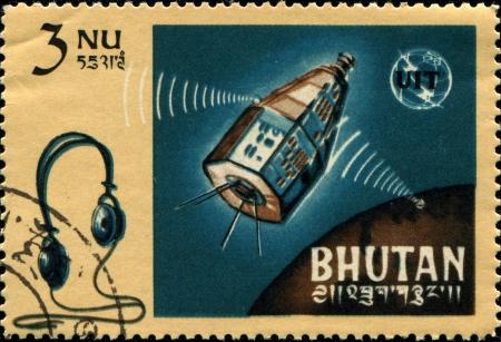centenary: BHUTAN - CIRCA 1966: A stamp printed in Bhutan honoring Centenary of International Telecommunications Union, shows Relay and headphones, circa 1966