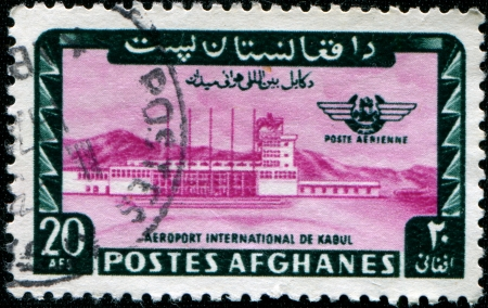 AFGHANISTAN - CIRCA 1964: A stamp printed in Afghanistan shows International airport in Kabul, circa 1964 photo