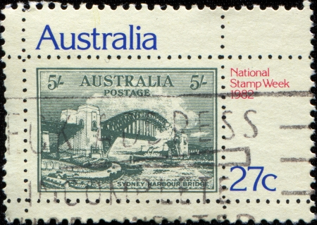 AUSTRALIA - CIRCA 1982  A stamp printed in Australia honoring National Stamp Week, shows Sydney Harbour Bridge 5s  Stamp of 1932, circa 1982 photo