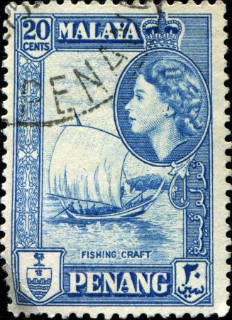 malaya: PENANG - CIRCA 1957: A stamp printed in Peneng  (Malaya) shows  Fishing Craft and inset portrait of Queen Elizabeth II, circa 1957  Editorial