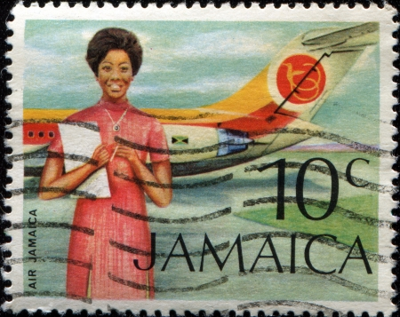 vickers: JAMAICA - CIRCA 1972: A stamp printed in Jamaica shows Air Jamaica Hostess and Vickers VC-10 Stock Photo