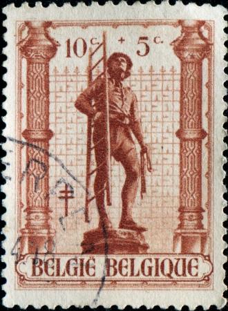 BELGIUM - CIRCA 1943: A stamp printed in Belgium shows Tiler statue  form Petit Sablon garden, Brussels, Brussels, circa 1943 photo