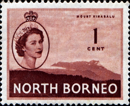 NORTH BORNEO - CIRCA 1950: A stamp printed in Nirth Borneo (Malaysia) shows Mount Kinabalu with portrait of Queen Elizabeth II