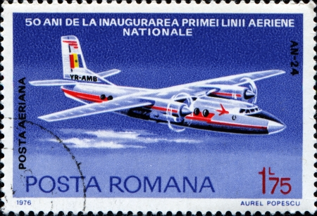 ROMANIA - CIRCA 1976: A stamp prtinted in Romania honoring 50th Anniversary of Romanian Airline, shows Antonov An-24, circa 1976  Stock Photo - 14093233
