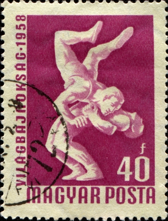 wrestlers: HUNGARY - CIRCA 1958: A stamp printed in Hungary honoring World Wrestling Championships, Budapest, shows Wrestlers, circa 1958