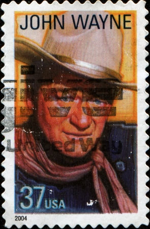 john wayne: USA - CIRCA 2004: A stamp printed in United States of America shows famous american movies western actor John Wayne, circa 2004  Stock Photo