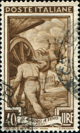 trundle: ITALY - CIRCA 1950: A stamp printed in Italy shows Carter and wagon, Glazio, circa 1950