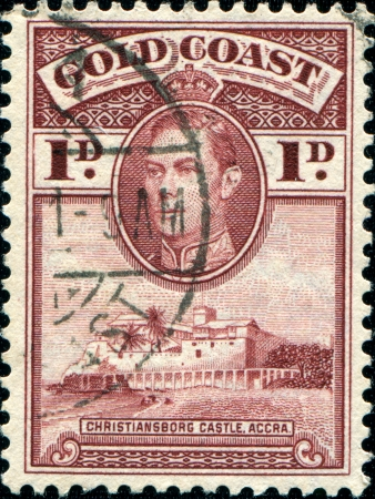 GOLD COAST - CIRCA 1938  A stamp printed in Gold Coas shows King George VI and Christiansborg Castle, Accra, circa 1938  Editorial