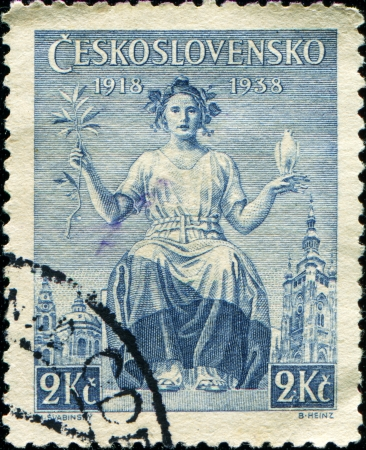 CZECHOSLOVAKIA - CIRCA 1938  A stamp printed in Czechoslovakia shows woman with laurel branch and white dove in her hands, honoring 20th Anniv of Czech Republic, circa 1938