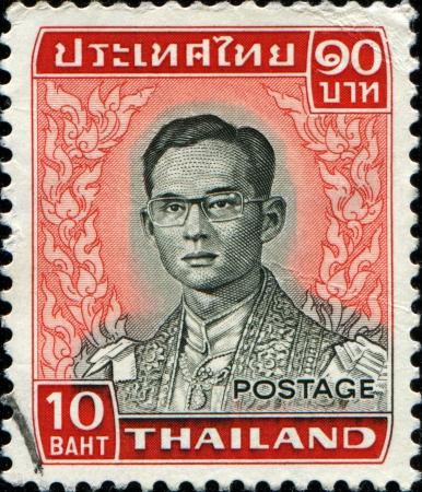adulyadej: THAILAND - CIRCA 1970  A stamp printed in Thailand shows King Bhumibol Adulyadej, circa 1970