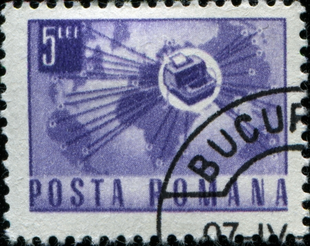 ROMANIA - CIRCA 1967  A stamp printed in Romania shows Telex instrument and world map, circa 1967  Stock Photo - 14147075