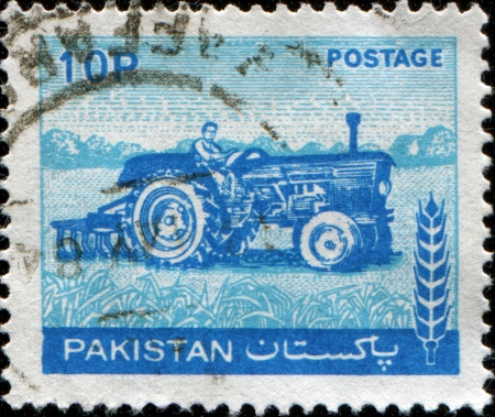 PAKISTAN - CIRCA 1970  A stamp printed in Pakistan shows woman tractor driver , circa 1970  Stock Photo - 14147138
