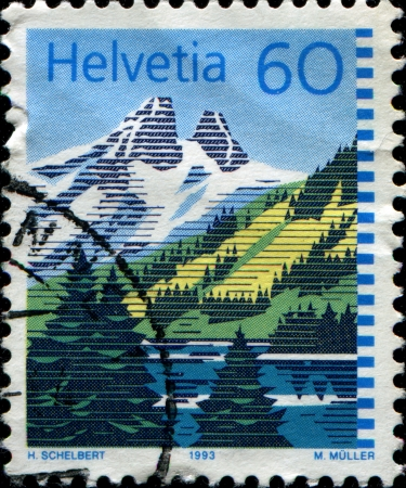 mount price: SWITZERLAND - CIRCA 1993  A stamp printed in Switzerland, shows the lake Lac de Taney, circa 1993