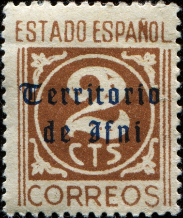 enclave: SPAIN - CIRCA 1948  A stamp printed in Sapain with underprint Territorio de Ifni  Ifni - a former Spanish province, an enclave on the Atlantic coast of modern Morocco, part of Spanish Morocco , circa 1948