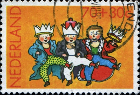 NETHERLANDS - CIRCA 1985  A greeting Christmas stamp printed in Netherlands shows three dancing boys dressed as kings, circa 1985