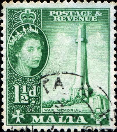 MALTA - CIRCA 1956  A stamp printed in Malta shows World War II Memorial, circa 1956