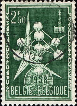 BELGIUM - CIRCA 1958  A stamp printed in Belgium honoring Brussels International Exhibition, shows Atomium and Exhibition Emblem, circa 1958