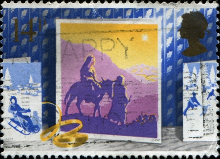 UK - CIRCA 1988  A Greeting Christmas stamp printed in United Kingdom shows escape to Egypt, circa 1988