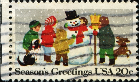 UNITED STATES - CIRCA 1982  A stamp printed in United States of America shows children Building a snowman, circa 1982  photo