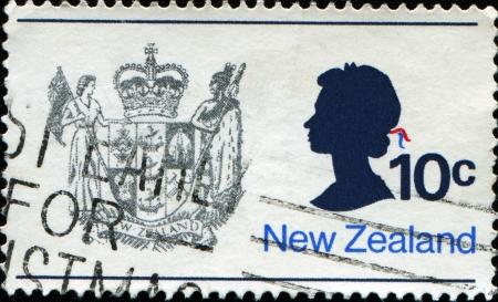 queen elizabeth ii: NEW ZEALAND - CIRCA 1970  A stamp printed in New Zealand shows the New Zealand Coat of Arms and Queen Elizabeth II, circa 1970