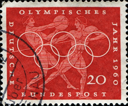 GERMANY - CIRCA 1960  A stamp printed in Germany shows Greek javelin and discus throwers, circa 1960