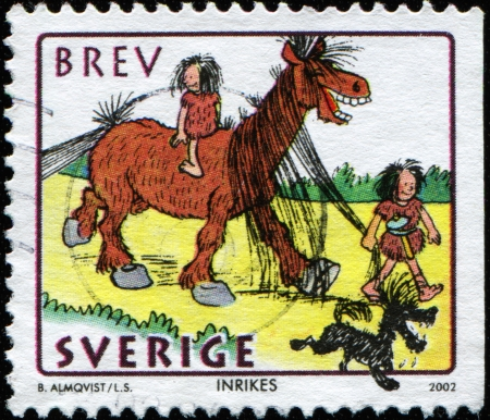 neanderthal women: SWEDEN - CIRCA 2002  A stamp printed in Sweden shows Sweden man leads a horse with a woman sitting on her back, circa 2002 Stock Photo