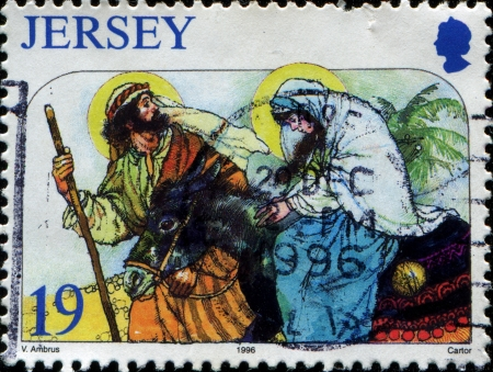 JERSEY - CIRCA 1996  A Greeting Christmas stamp printed in Jersey shows escape to Egypt, circa 1996 photo