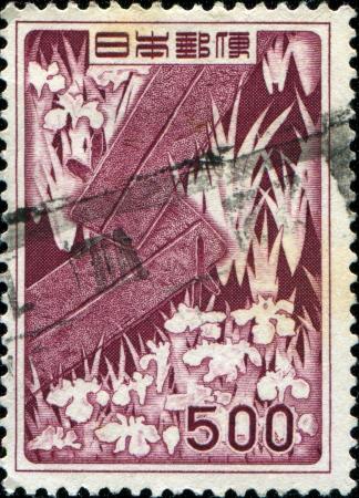 JAPAN - CIRCA 1952  A stamp printed in Japan shows Bridge and Irises, circa 1952 Stock Photo - 14149450