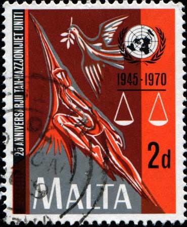 un used: MALTA - CIRCA 1970  A stamp printed in Malta honoring 25th Anniversary of UN, circa 1970