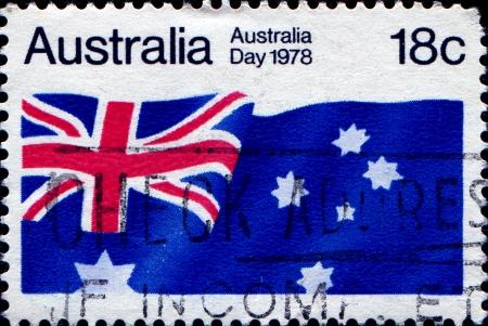 honoring: AUSTRALIA - CIRCA 1978  A stamp honoring Australia Day shows flag of Australia , circa 1978  Stock Photo