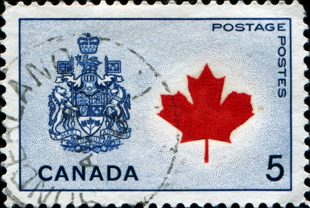 CANADA - CIRCA 1965  A stamp printed in Canada shows Maple leaf and coat of arms of Canada, circa 1965 Stock Photo - 14149851