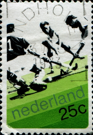 NETHERLANDS - CIRCA 1973  Stamp printed in Netherlands shows field hockey, circa 1973