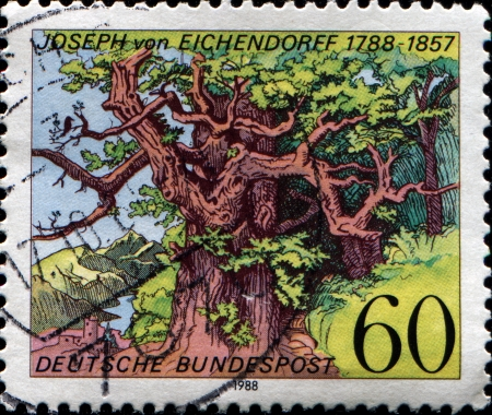 poem: GERMANY - CIRCA 1988  A stamp printed in Federal Republic of Germany honoring  Birth Bicentenary of Joseph von Eichendorff  writer , shows Solitude of the Green Woods  woodcut of poem, Ludwig Richter , circa 1988